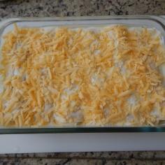 cubra com o creme e o queijo